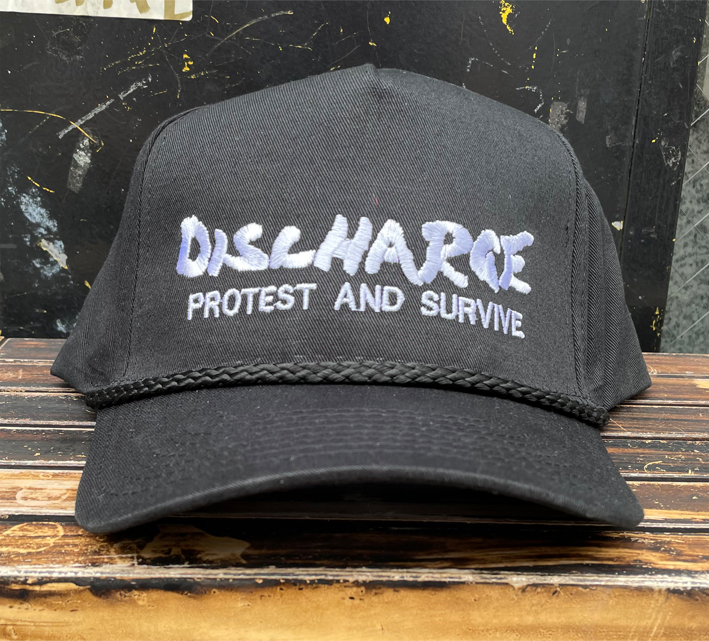 DISCHARGE CAP PROTEST AND SURVIVE