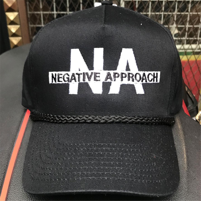 NEGATIVE APPROACH CAP LOGO